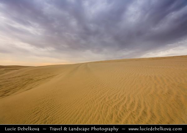 "Middle East - GCC - Qatar - Qatari Desert - Area around Spectacular Khor al Adaid - ""Inland Sea"" - Large sand dunes area during stormy sunset"