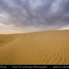 "Middle East - GCC - Qatar - Qatari Desert - Area around Spectacular Khor al Adaid - ""Inland Sea"" - Large sand dunes area during stormy sunset"