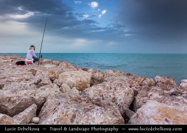 Qatar - Al Wakrah - Al Waqra - Al Waqrah - Fisherman fishing on the sea shore at dawn