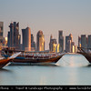 Middle East - Qatar - Doha - الدوحة‎ - ad-Dawḥa - ad-Dōḥa - New and Modern Skyline with Sky High Skyscrapers along the Corniche and traditional boats - Dhow