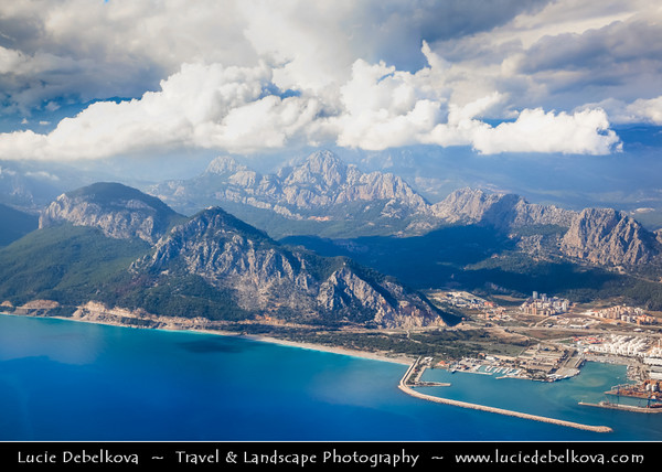 Middle East - Turkey - Türkiye - Mediterranean coast of southwestern Turkey - Antalya - International sea resort located on the Turkish Riviera - Sprawling modern city with Taurus Mountains in the background - Aerial View