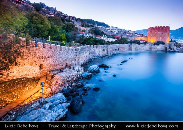 Middle East - Turkey - Türkiye - Mediterranean coast of southwestern Turkey - Antalya Province - Alanya - Alaiye - Beach resort city located on the Turkish Riviera below the Taurus Mountains - Historical town center & harbor with Red Tower - Kızıl Kule - Symbol of the city