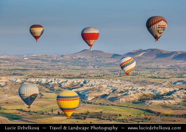 Turkey - Türkiye - Central Anatolia - Nevşehir Province - Cappadocia - Capadocia - Kapadokya - Kappadokía - UNESCO World Heritage Site - Göreme National Park - Spectacular volcanic surrealistic landscape entirely sculpted by erosion with Fairy Chimneys rock formation - One of the best places to fly with hot air balloon