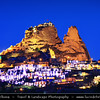 Turkey - Türkiye - Central Anatolia - Nevşehir Province - Cappadocia - Capadocia - Kapadokya - Kappadokía - UNESCO World Heritage Site - Göreme National Park - Spectacular volcanic surrealistic landscape entirely sculpted by erosion with Fairy Chimneys rock formation -  Uchisar Castle during Dusk - Twilight - Blue Hour