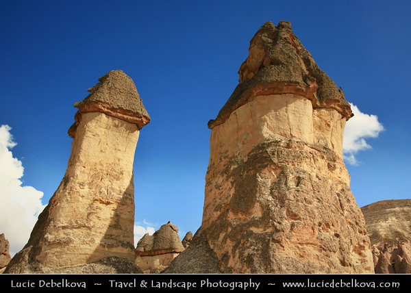 Turkey - Türkiye - Central Anatolia - Nevşehir Province - Cappadocia - Capadocia - Kapadokya - Kappadokía - UNESCO World Heritage Site - Göreme National Park - Spectacular volcanic surrealistic landscape entirely sculpted by erosion with Fairy Chimneys rock formation - Pasabag - Monks Valley - Highly remarkable earth pillars - Pasabag valley contains some of the most striking fairy chimneys in Cappadocia with twin and even triple rock caps