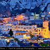 Turkey - Türkiye - Central Anatolia - Nevşehir Province - Cappadocia - Capadocia - Kapadokya - Kappadokía - UNESCO World Heritage Site - Göreme National Park - Spectacular volcanic surrealistic landscape entirely sculpted by erosion with Fairy Chimneys rock formation - Göreme Town from above with its surrounding lunar landscape during Dusk - Twilight - Blue Hour