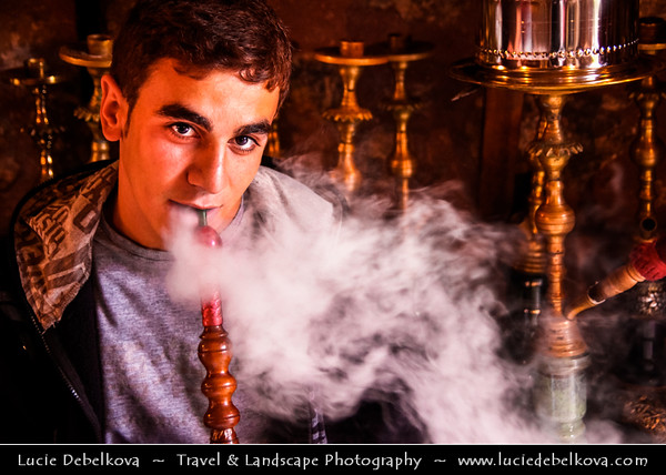 Turkey - Türkiye - Istanbul - Ancient Byzantium & Constantinople - Grand Bazaar - Kapalıçarşı - One of the largest & oldest covered markets in the world, with 61 covered streets & over 3,000 shops - Young man smoking traditional Shisha or Hookah pipe