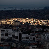 Sunlight spotlights a section of the European side of Istanbul, as seen from Sisli.