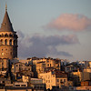 Istanbul's Galata Tower lit by late afternoon light.
