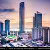 Middle East - GCC - United Arab Emirates - UAE - Emirate of Abu Dhabi - Abu Dhabi - Area of Al Ittihad Square with Sky high modern buildings and small traditional mosques beneath them