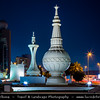 Middle East - GCC - United Arab Emirates - UAE - Emirate of Abu Dhabi - Abu Dhabi - Al Ittihad Square - Architectural statement of national identity with Emirati cultural symbols - traditional incense burner (mabakhir), coffee pot (dallah) and a conical palm-frond food cover (makkabah) on grand scale as iconic monuments - Dusk - Twilight - Blue Hour - Night