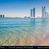 Middle East - GCC - United Arab Emirates - UAE - Abu Dhabi - Crystal clear waters of corniche in front of brand new modern skyline with sky high skyscrapers