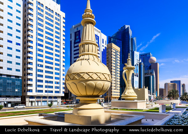 Middle East - GCC - United Arab Emirates - UAE - Emirate of Abu Dhabi - Abu Dhabi - Al Ittihad Square - Architectural statement of national identity with Emirati cultural symbols - traditional incense burner (mabakhir), coffee pot (dallah) and a conical palm-frond food cover (makkabah) on grand scale as iconic monuments