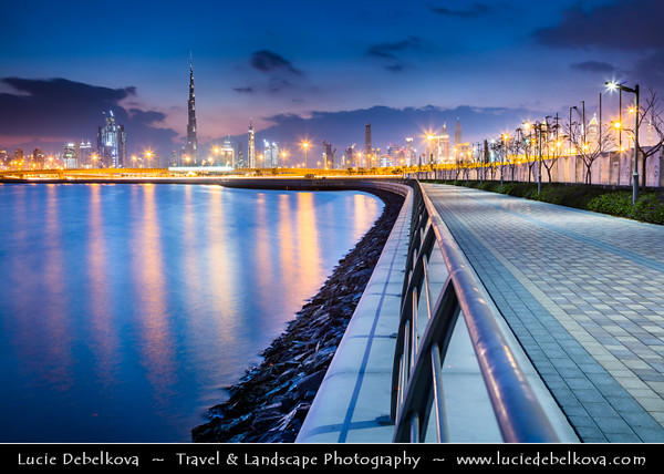 Middle East - GCC - United Arab Emirates - UAE - Dubai - Dubai Water Canal - Dubai Creek - Artificial canal with modern sky high buildings with iconic Burj Khalifa - Khalifa Tower - Skyscraper & tallest man-made structure in world at 829.8 m (2,722 ft) - Twilight  - Blue Hour - Night - Dusk