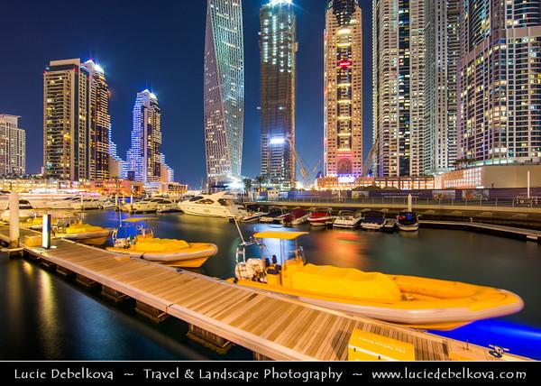Middle East - GCC - United Arab Emirates - UAE - Dubai - Dubai Marina - Artificial canal city with sky high modern buildings along the sea shore - Twilight - Blue Hour - Night - Dusk