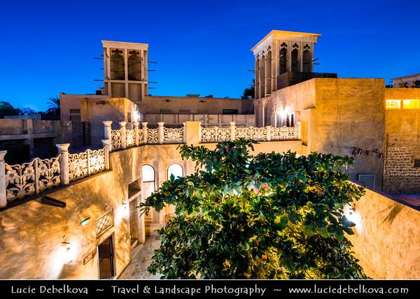 Middle East - GCC - United Arab Emirates - UAE - Dubai - Bastakiya quarter - Historical neighborhood established at the end of the 19th century by well-to-do textile and pearl traders from Bastak, Iran - Labyrinthine lanes are lined with restored merchant's houses and iconic Bastakiya mosque - Twilight - Blue Hour - Night - Dusk