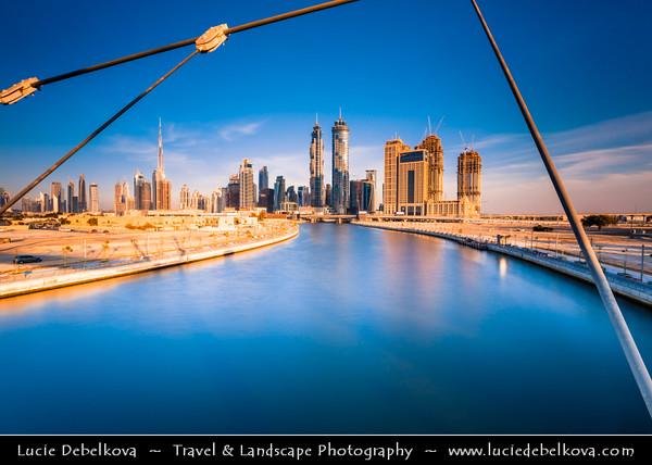 Middle East - GCC - United Arab Emirates - UAE - Dubai - Dubai Water Canal - Dubai Creek - Artificial canal with bridges leading to modern sky high buildings with Burj Khalifa  - Khalifa Tower - Skyscraper & tallest man-made structure in world at 829.8 m (2,722 ft)