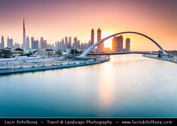 Middle East - GCC - United Arab Emirates - UAE - Dubai - Dubai Water Canal - Dubai Creek - Artificial canal with bridges leading to modern sky high buildings with Burj Khalifa - Khalifa Tower - Skyscraper & tallest man-made structure in world at 829.8 m (2,722 ft)