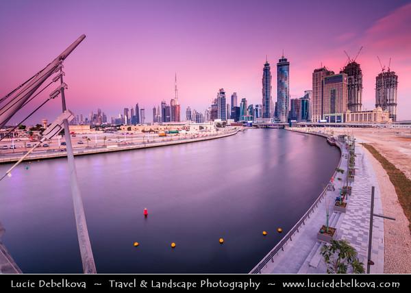 Middle East - GCC - United Arab Emirates - UAE - Dubai - Dubai Water Canal - Dubai Creek - Artificial canal with bridges leading to modern sky high buildings with Burj Khalifa