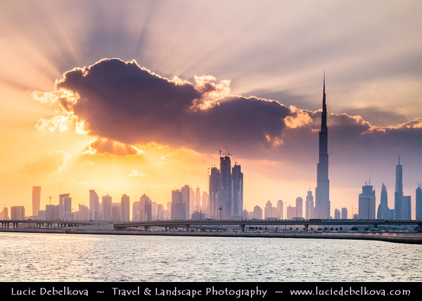 Middle East - GCC - United Arab Emirates - UAE - Dubai - Dubai Water Canal - Dubai Creek - Artificial canal with modern sky high buildings with iconic Burj Khalifa - Khalifa Tower - Skyscraper & tallest man-made structure in world at 829.8 m (2,722 ft) - Beautiful Sunset with with dramatic clouds