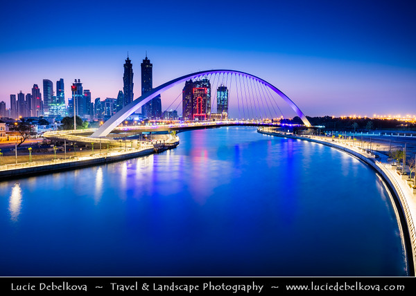 Middle East - GCC - United Arab Emirates - UAE - Dubai - Dubai Water Canal - Dubai Creek - Artificial canal with bridges leading to modern sky high buildings with Burj Khalifa