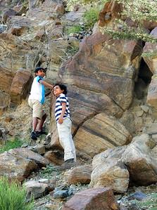 Children climbing wadi wall