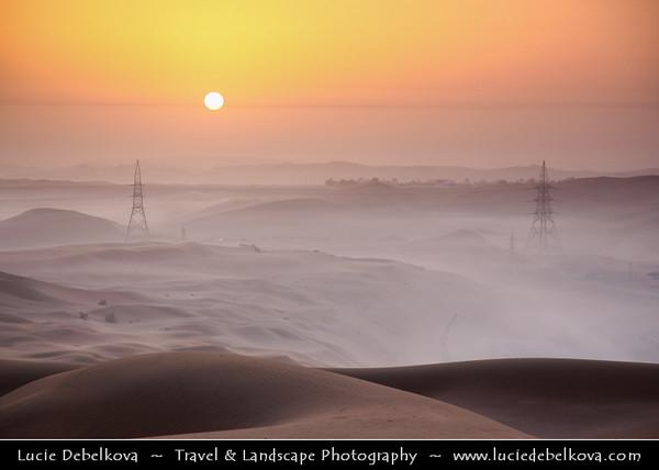 Middle East - GCC - United Arab Emirates - UAE - Abu Dhabi Emirate - Empty Quarter Desert - Rub Al Khali - Arabian Desert - Spectacular sea of sand dunes with mystical morning mist at Sunrise