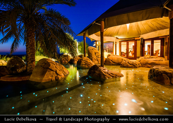 Middle East - GCC - United Arab Emirates - UAE - Emirate of Abu Dhabi - Al Ain desert area with endless sea of sand dunes - Spectacular luxury hotel resort in the middle of sand dunes at Dusk - Twilight - Blue Hour - Night