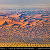 Middle East - GCC - United Arab Emirates - UAE - Emirate of Abu Dhabi - Al Ain desert area with endless sea of sand dunes - View from above - Aerial view
