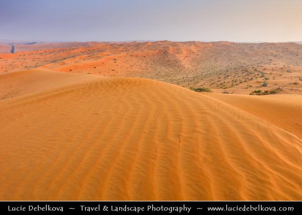 Middle East - GCC - United Arab Emirates - UAE - Emirate of Ras Al Khaimah - RAK - Sea of sand dunes in vast desert landscape during Sunrise
