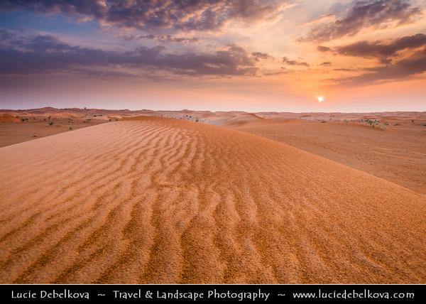 Middle East - GCC - United Arab Emirates - UAE - Emirate of Ras Al Khaimah - RAK - Sea of sand dunes in vast desert landscape during sunset