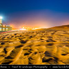 Middle East - GCC - United Arab Emirates - UAE - Emirate of Sharjah - Lonely Mosque in sea of sand dunes in vast desert landscape at Dusk - Twilight - Blue Hour - Night