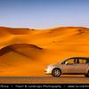 Middle East - GCC - United Arab Emirates - UAE - Abu Dhabi Emirate - Empty Quarter Desert - Rub Al Khali - Arabian Desert - Spectacular sea of sand dunes - Desert Road and a lonely car