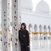A female tourist poses for a photo at the Sheikh Zayed Grand Mosque in Abu Dhabi, UAE.