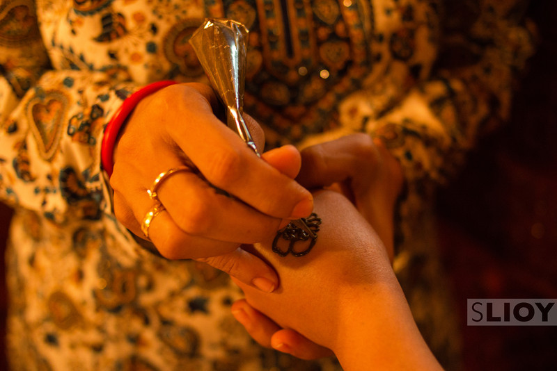 Henna painter on a dhow cruise.<br /> <br /> Dubai, United Arab Emirates