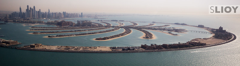 A Helicopter view over Palm Jumeirah, with the Dubai Marina in the background.