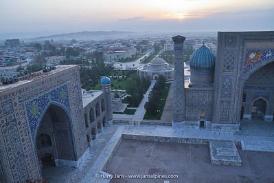 view over Samarkand (sand/dessert) with the Tilya-Kori Madrasah (l) & Sher-Dor Madrasah (r)