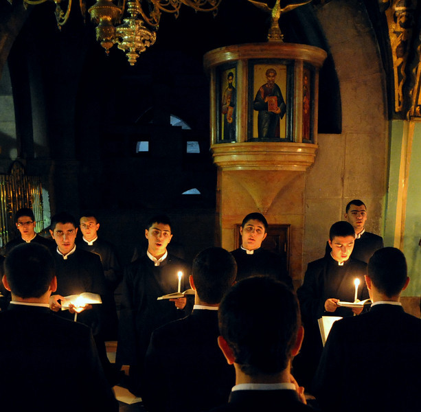 In the Church of the Holy Sepulchre, various christian monks pray thoughout the day. This is the armenian monks singing