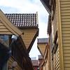 Bergen: Bryggen: Alley between buildings with jutting roofs