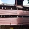 Bergen: Bryggen: Warehouse with hoist and doors on upper floors