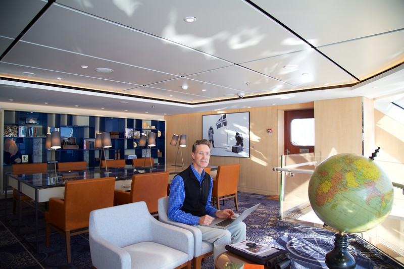 Viking Sea: Peter in upper Explorers' Lounge with globe