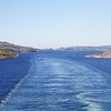 Viking Sea: Leaving Rørvik from stern with bridge, wake and channel lights