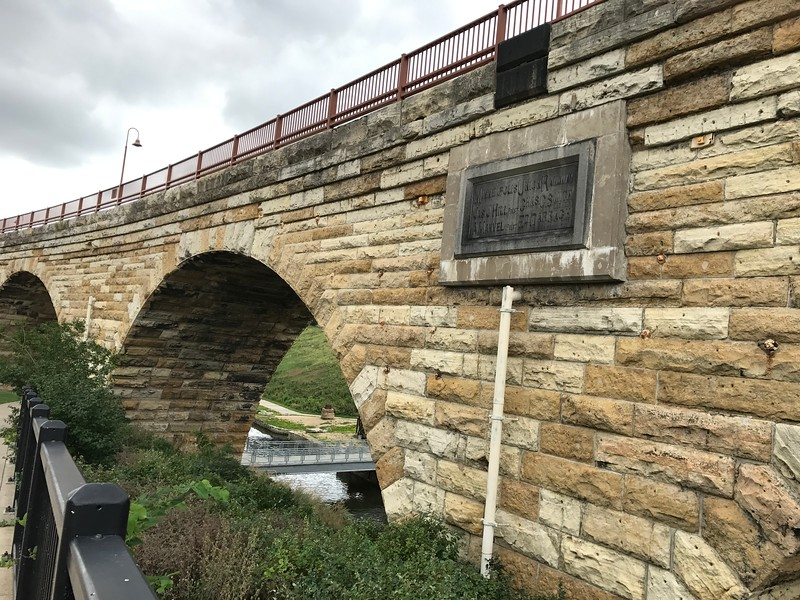 Stone arch bridge spanning the Mississippi River.  Now it is a walk/bike path across the river as well as a historic site/park.