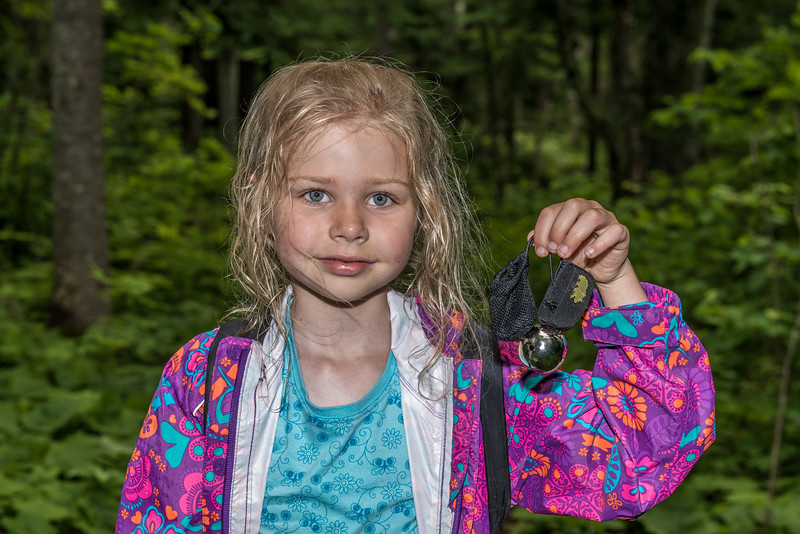 Naomi found a bear bell in the middle of the track. Was this the leftover of a bear's meal?