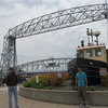 """Saturday, June 15th 2013-Friends (Chris & Adnan-visiting from Pakistan) at the famous Duluth """"Lift Bridge""""...<br /> <br /> <a href=""""http://www.tripadvisor.com/Attraction_Review-g43018-d109911-Reviews-Aerial_Lift_Bridge-Duluth_Minnesota.html"""">http://www.tripadvisor.com/Attraction_Review-g43018-d109911-Reviews-Aerial_Lift_Bridge-Duluth_Minnesota.html</a><br /> Description: Originally constructed in 1905 as an aerial lift, this unusual elevator bridge is 386 feet long and spans the canal entrance to Duluth Harbor."""