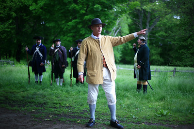 Colonial figure busts out a period disco move while explaining all about muskets and the soldiers who wielded them.