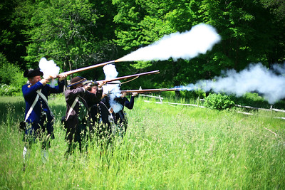 Firing muskets, which couldn't hit the broad side of a barn. Literally.