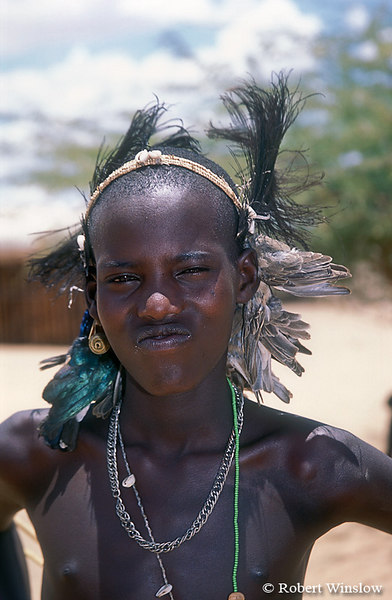 Defiant Looking, Samburu Male Wearing Feathers and Dead Birds after Circumcision, Kenya, Africa