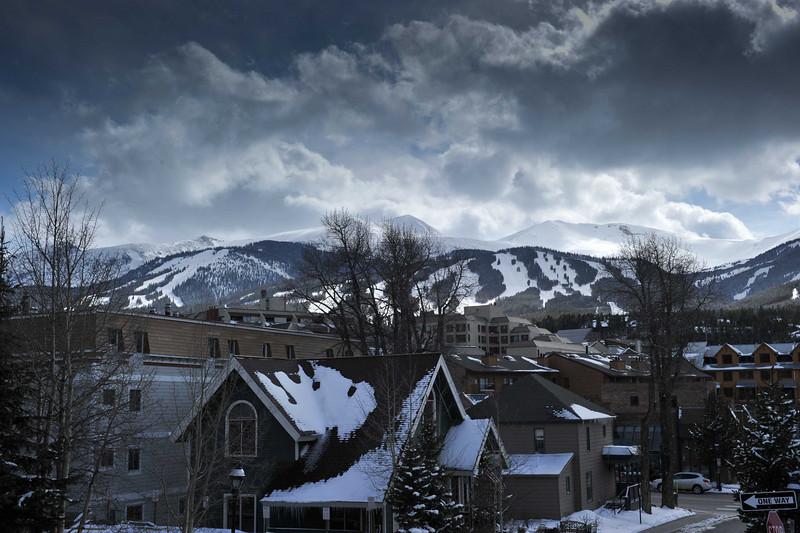 Breckenridge, Colorado with ski trails on the mountains