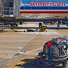 Title: Refuel<br /> Date: November 2008<br /> DFW Airport TX - An American Airlines mechanic works on an American Airlines plane at DFW Airport.